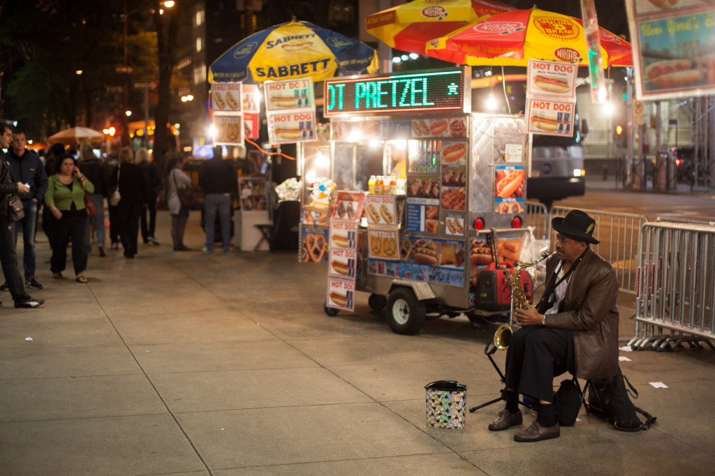 A beggar making music on 5th Ave.